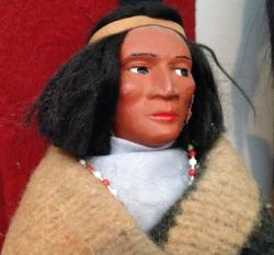Skookum Doll looking left